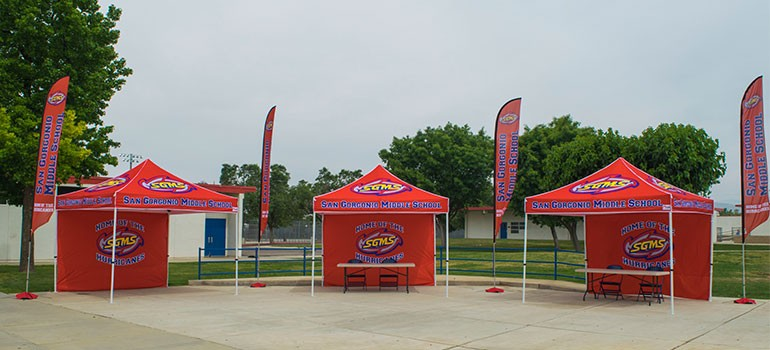 Uses for custom canopies, flags, and banners